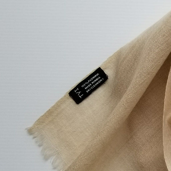 close up of 100% real pashmina wool product label on genuine pashmina scarf