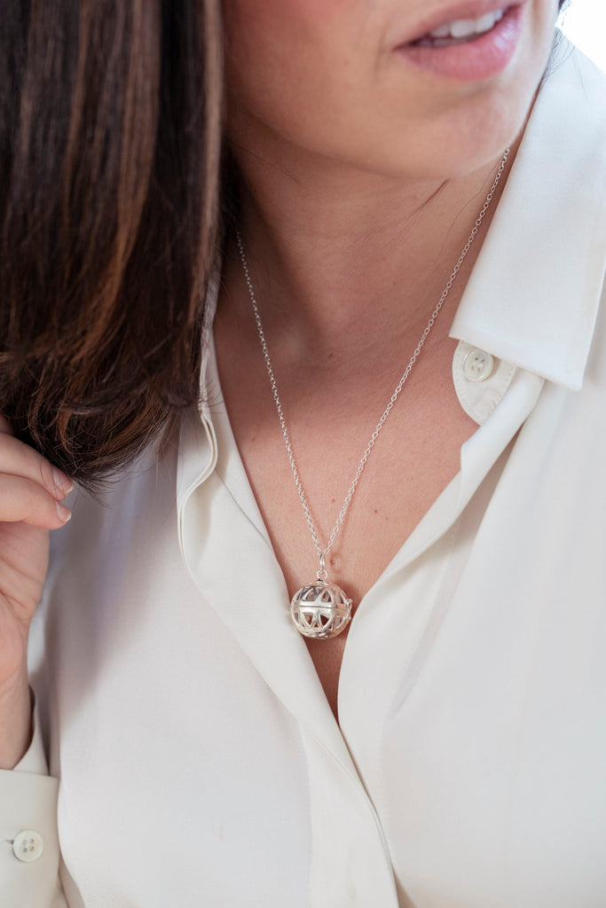 Model wearing the aromatherapy heart locket