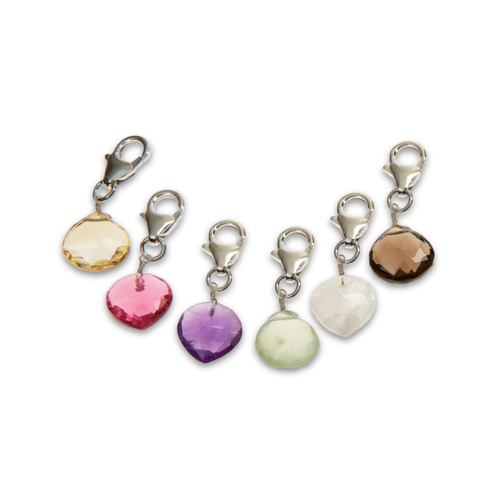 A collection of five heart-shaped charms in moonstone, citrine, smoky quartz, amethyst, phrenite, and pink quartz