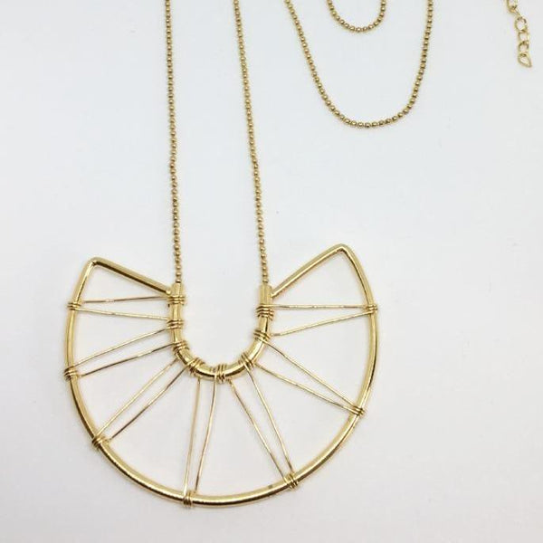 gold semi-circle pendant with triangular wire detailing designed in Canada and made in India