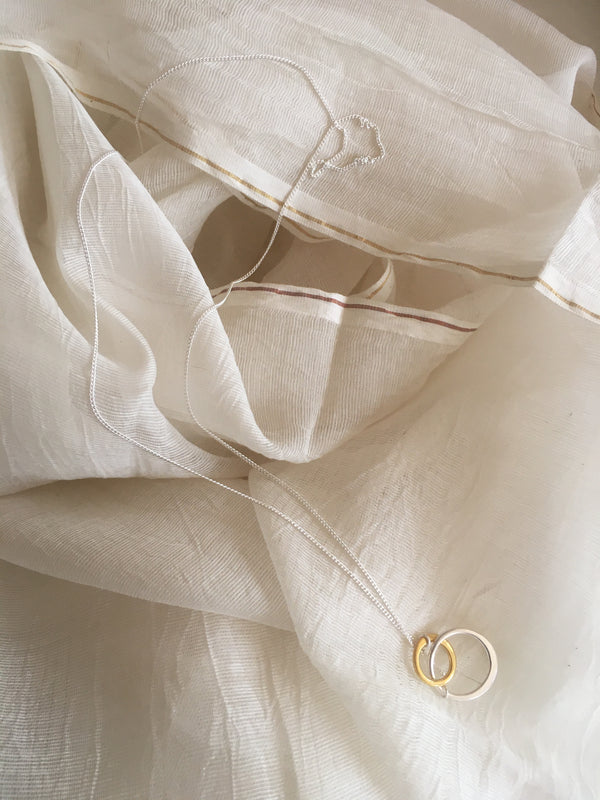 Ultra fine natural silk and cotton scarf with a TYI Necklace placed on top