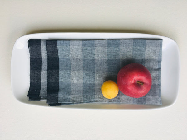 Muted Blue-Grey Linen Table Napkins placed on plate with fruits, made in India