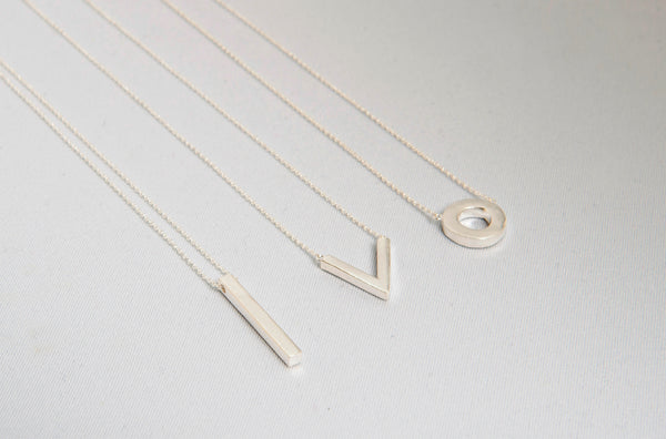 Minimal V Necklace - Sterling Silver beside 2 other necklaces, All by Thank You India