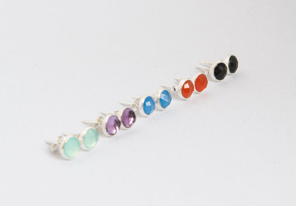 A collection of 5 sterling silver studs with faceted semi-precious stones in blue chalcedony, aqua chalcedony, purple amethyst, black onyx and carnelian
