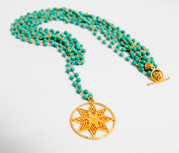 our strands of turquoise beads and gold plated on silver detailing in white background by Thank You India