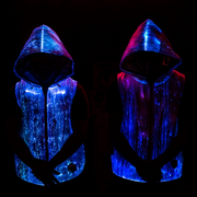 "Man wearing Inlighten ""Enhanced Revival Hoodie,"" a super bright fiber optic light up sleeveless hoodie (blue) for music festivals"