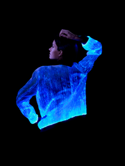 "Man wearing the Inlighten ""Prophecy Bomber,"" a fiber optic light up jacket (dark blue) for music festivals"