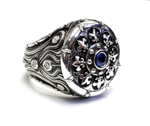 Silver Fleur De Li Ring With Diamonds And Blue Sapphire By Sacred Angels