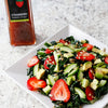 Strawberry Kale Salad with English cucumber, avocado and sunflower seeds with a light, flavorful vinaigrette made with Strawberry Balsamic Vinegar and Sicilian Lemon Infused Olive Oil.
