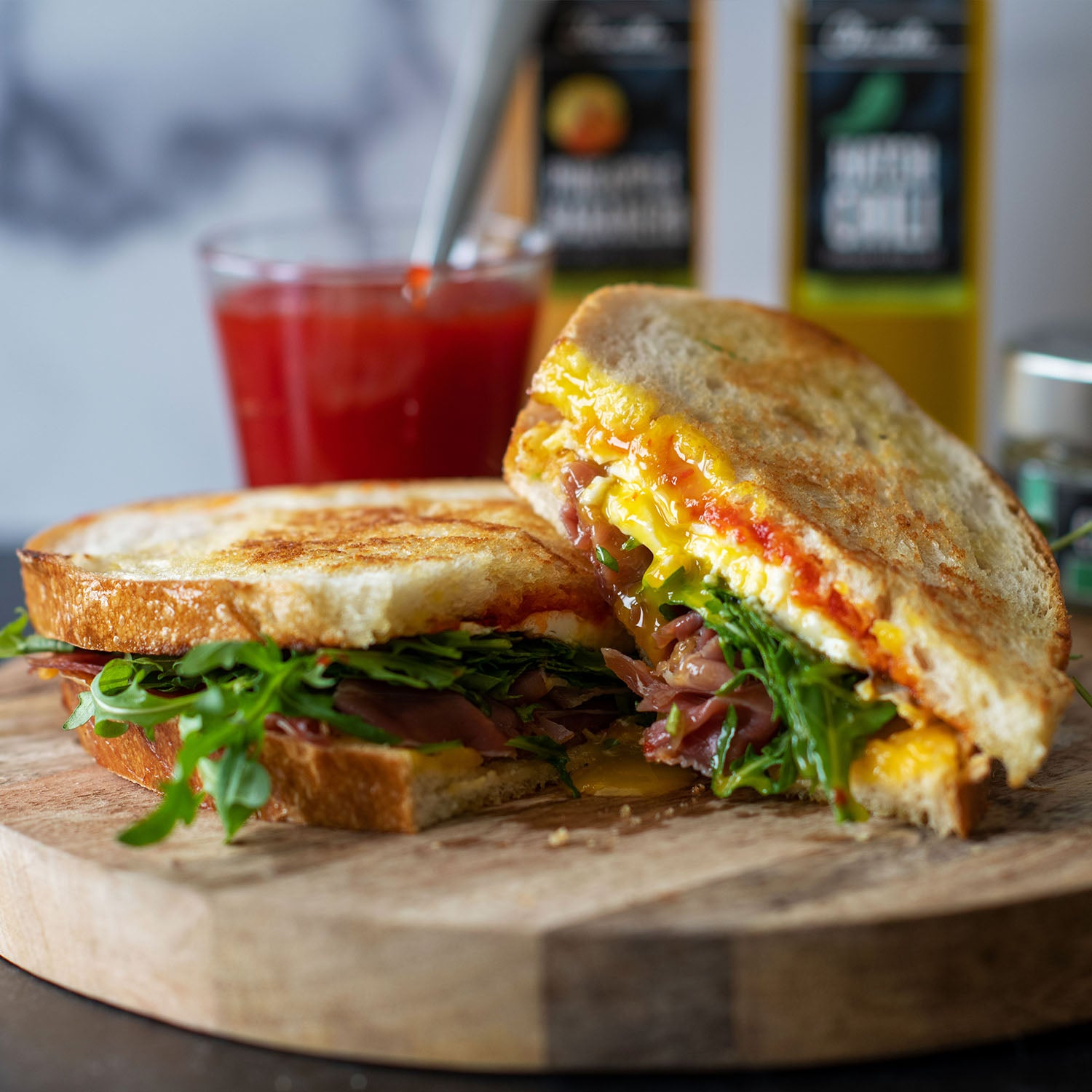Fried Egg, Prosciutto, and Red Pepper Jam Breakfast Sandwich