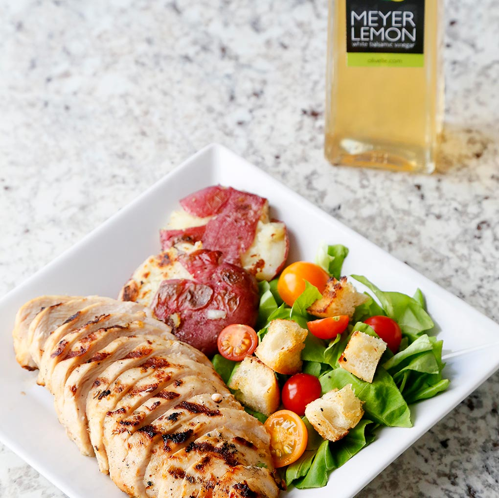 Lemon & Herb Marinated Chicken with Green Salad with Tomatoes and Croutons and a side of Roasted Vegetables using the Meyer Lemon White Balsamic Vinegar.