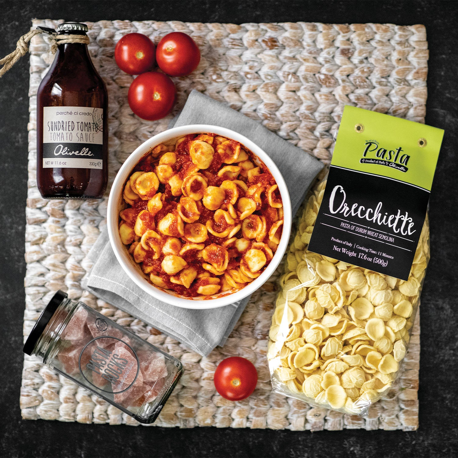 Black gift box, oreccheitte pasta, ricotta tomato sauce, and pasta rocks as an example of what to chose in your gift kit.