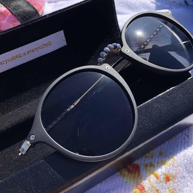 sunglasses ARCHER Matte Black Retro Round Sunglasses with Blue Sapphire Gemstones Lisa Ing