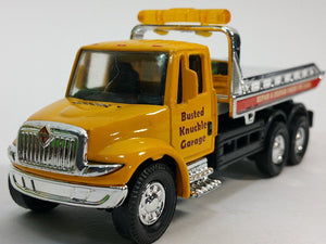 Showcast International Yellow Busted Knuckle Flatbed Tow Truck 1/64 Scale