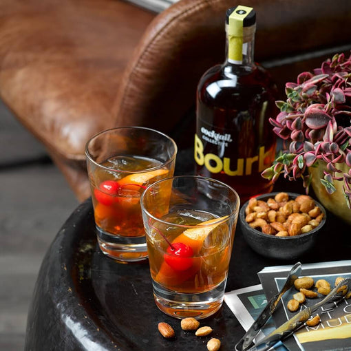 Bourbon old fashioned with bourbon bottle | cocktail collective