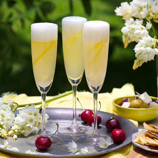 French 75 cocktail with cherries | Cocktail Collective