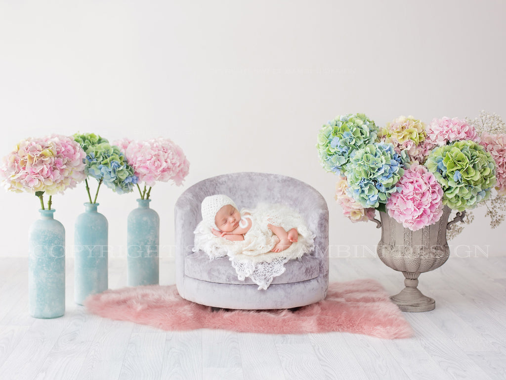 Newborn Digital Backdrop - Beautiful multicoloured hydrangeas around a grey chair with a white knitted throw
