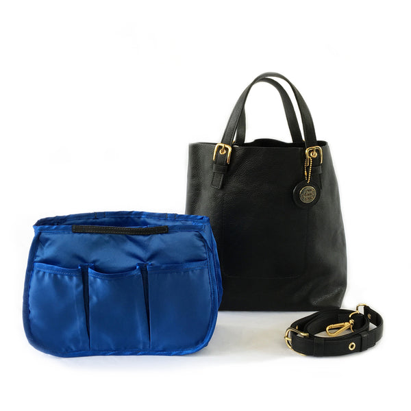 One Plane Jane ALPHA black leather pilot tote flight bag with double buckle handles.  Front view with One Plane Jane removable keychain charm, blue removable organizer and shoulder strap.