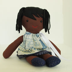 Bessie the STEM Doll with airplane builder - pilot dress. Hand-made. Black hair and eyes, tan skin.  Front seated view.
