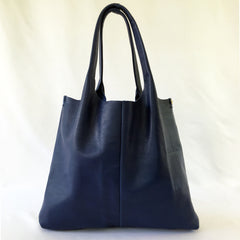 One Plane Jane Travel, Shopping Tote shown in blue leather.  Full front view with handle