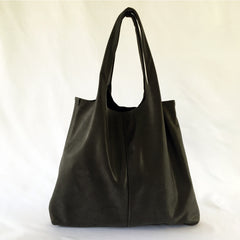One Plane Jane Travel, Shopping Tote shown in charcoal leather.  Full front view with handle