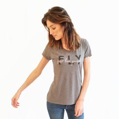 "One Plane Jane FLY First Love Yourself graphic tshirt tee. Shown in grey with ""FLY"" in charcoal print and ""first love yourself"" in white script print. V- Neck and short sleeves."