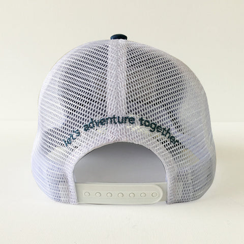 "One Plane Jane Trucker Hat - Back View. White mesh with ""let's adventure together"" embroider on back. Designed for women."