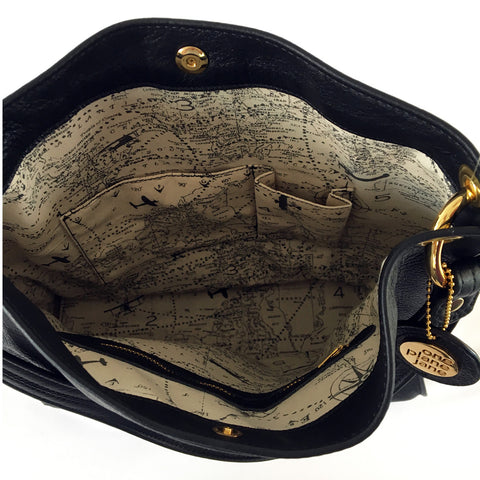 One Plane Jane Charlie Leather Handbag. Side view showing edges and handle ring attachment