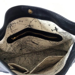 One Plane Jane Charlie Leather Handbag.  Interior view of airplane, map design, zip pocket, magnetic closure