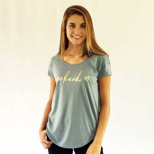 "One Plane Jane Golden Weekend Tee.  Show in Blue with ""Weekend"" and a heart printed in gold-leaf."