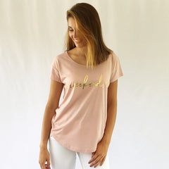 "One Plane Jane Golden Weekend Tee.  Show in Rose Quartz with ""Weekend"" and a heart printed in gold-leaf."