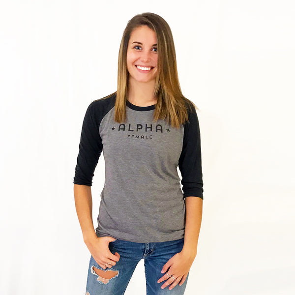 One Plane Jane Alpha Female Baseball Tee shown in grey/ black with black letters . Super soft tri-blend.. Inspired by pilots, aviators but perfect for all strong independent women.