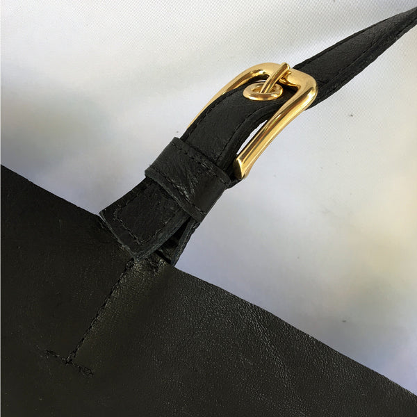 ALPHA Black Leather Pilot Flight Tote Bag with gold hardware and a removable organizer.  Handle buckle detail and view.  Heavy duty with style.  Perfect for pilots, general aviators, or anyone that likes an organized tote bag.