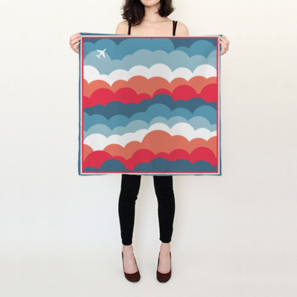Square silk scarf in the fun One Plane Jane signature cloud print.  An airplane is strategically placed in the corner to show your love of the sky.  Wear it with a blouse or dress up a t-shirt