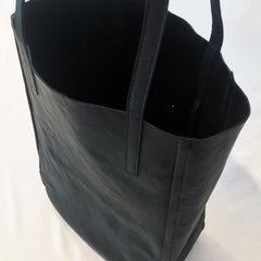 One Plane Jane Delta Travel tote in black leather.  Top view looking into the unlined interior