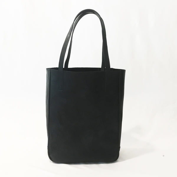 One Plane Jane Delta Travel tote in black leather.  Front view with straps up