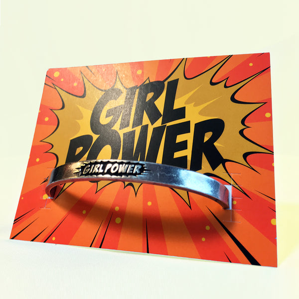 "Girl Power Pewter adjustable cuff bracelet with backer card. ""Girl Power"" pictured in a starburst on the face."