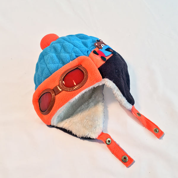 Baby bomber hat.  Blue, orange and navy blue hat with faux aviator glasses and ear flaps