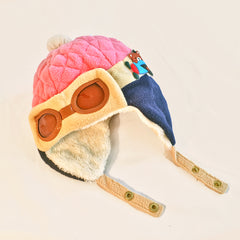 Baby bomber hat.  Pink, tan and navy blue hat with faux aviator glasses and ear flaps