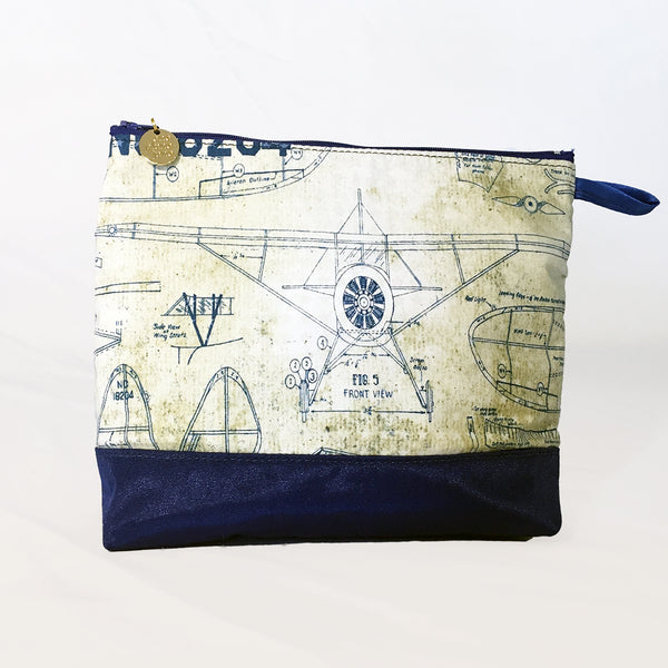 One Plane Jane Airplane Blueprint Small Cosmetic bag pouch. Cream and blue design featuring old world airplane blueprints.  Zippered top and One Plane Jane zipper charm.