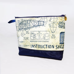 One Plane Jane Airplane Blueprint Small Cosmetic bag pouch. Cream and blue design featuring old world airplane blueprints.  Zippered top and One Plane Jane zipper charm