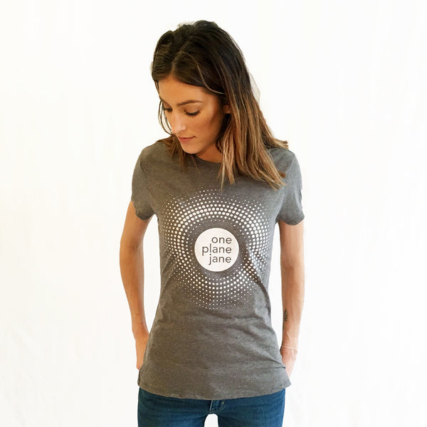 One Plane Jane Logo T-shirt shown in grey.  Round logo surrounded by a burst of dots for a feminine look.  White Ink