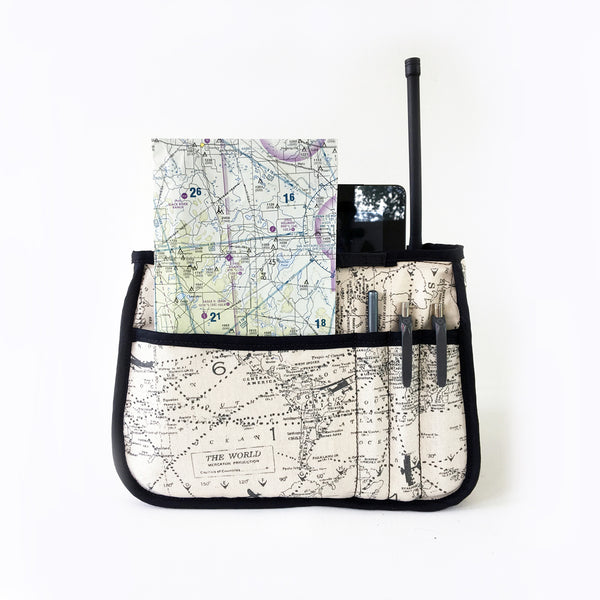 One Plane Jane Alpha tote organizer rear view.  Shown holding pens, chart, handheld radio and ipad.  Made of airplane/map canvas fabric.