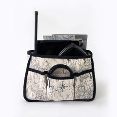 One Plane Jane Alpha tote organizer front view.  Shown holding charging cords in front pocket, ipad, headset and handheld radio.  Made of airplane/map canvas fabric.