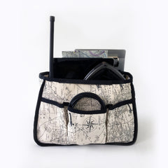 Front view of Tote Bag Organizer. 3 outside pockets perfect for cords, chargers or other small items. Organizer fabric is aviation, airplane and map theme.  Padded compartments designed for iPad, headset and much more. Perfect for pilots, general aviators, or anyone that likes an organized tote bag.