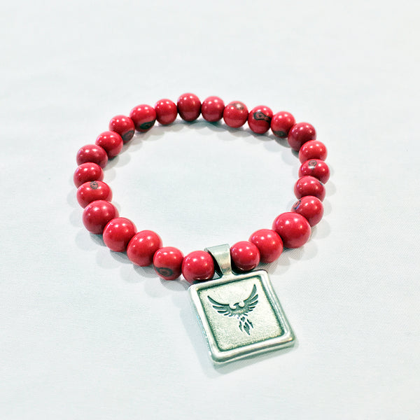 One Plane Jane Red Acai Bead Bracelet with pewter seal charm with a picture of a phoenix bird