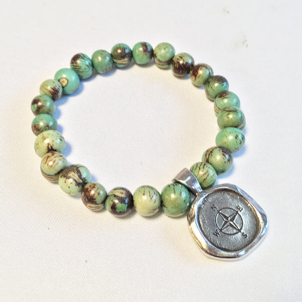 Compass Acai seed aqua beaded bracelet.  Seek/compass wax seal charm.