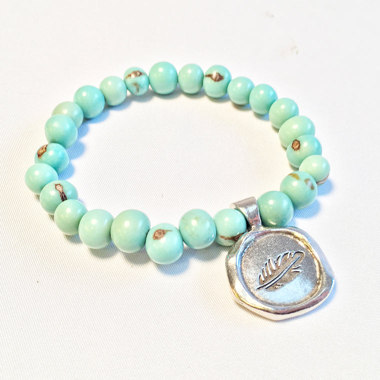 SOAR / FEATHER Acai Seed Baby Blue Beaded Bracelet