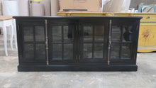 Entertainment unit with glass doors