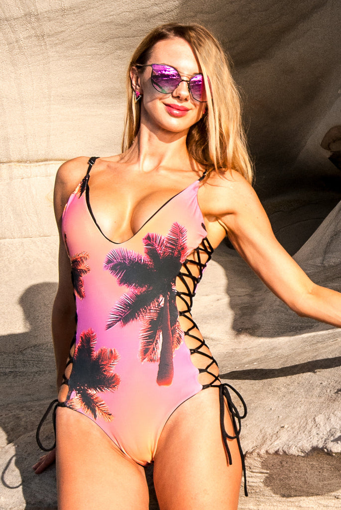 The plunging reversible lace-up one-piece